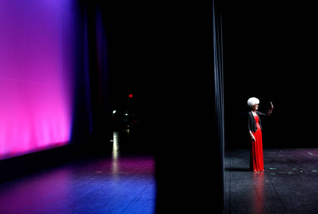 A contestant waves to the crowd during the evening gown portion of the Ms. Oklahoma Senior America Pageant. Photo by Bryan Terry, The Oklahoman