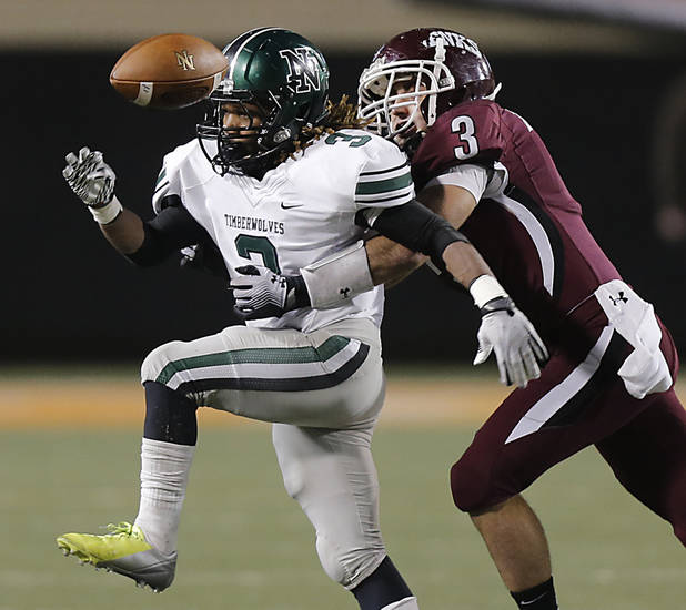 Jenks&#039; Kent Clark (3) breaks up a pass for Norman North&#039;s Bryan Payne (3) during the Class 6A Oklahoma state championship football game between Norman North High School and Jenks High School at Boone Pickens Stadium on Friday, Nov. 30, 2012, in Stillwater, Okla.   Photo by Chris Landsberger, The Oklahoman
