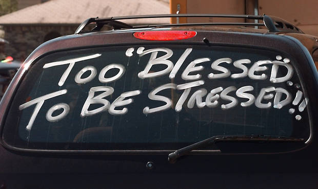 "Tornado damage: ""TOO BLESSED TO BE STRESSED!"": Regency Park housing Addition,  sign on homeowners car near 2009 Sunset.  Homeowners were retrieving belongings from damaged houses."