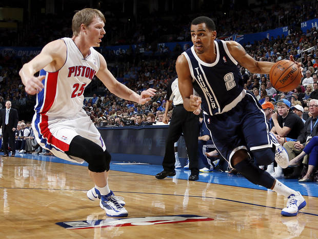 Oklahoma City's Thabo Sefolosha (2) drives the ball against Detroit's Kyle Singler (25) during an NBA basketball game between the Detroit Pistons and the Oklahoma City Thunder at the Chesapeake Energy Arena in Oklahoma City, Friday, Nov. 9, 2012. Oklahoma City won, 105-94. Photo by Nate Billings, The Oklahoman