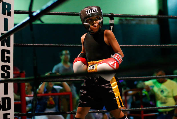 Chris Barba, 9, of Edmond, walks to the corner during his first fight at The Underground Arena in Oklahoma City, Saturday, June 15, 2013.  Photo by Bryan Terry, The Oklahoman