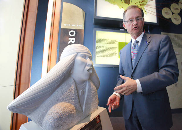 "Bob Blackburn, executive director of the Oklahoma Historical Society, is shown next to the sculpture by Allan Houser titled ""Apache.""  <strong>David McDaniel - The Oklahoman</strong>"