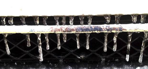 Icicles on the front grill of a vehicle in Midwest City grill