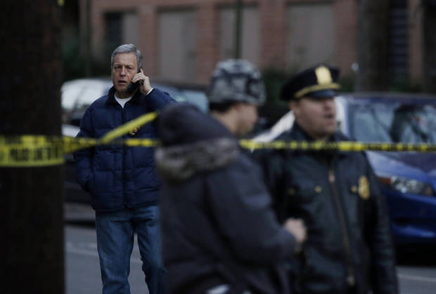 Hoboken Police Chief Anthony P. Falco, Sr., left, talks on the phone in Hoboken, N.J., Friday, Dec. 14, 2012, after local police and the FBI converged on a Hoboken residence near the intersection of 13th and Grand streets after a connection was reported with the shootings at the Sandy Hook Elementary School in Newton, Conn. (AP Photo/Mel Evans) ORG XMIT: NJME101