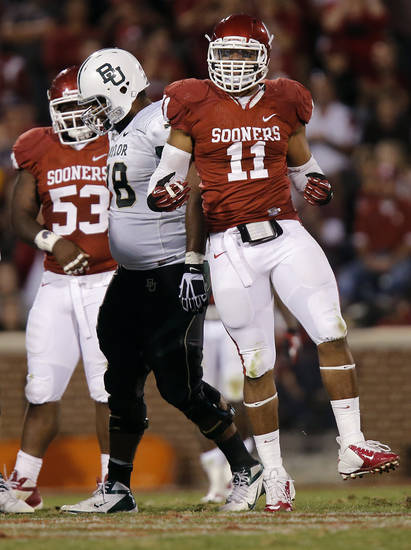 Oklahoma&#039;s R.J. Washington (11) reacts after a sack during the college football game between the University of Oklahoma Sooners (OU) and Baylor University Bears (BU) at Gaylord Family - Oklahoma Memorial Stadium on Saturday, Nov. 10, 2012, in Norman, Okla.  Photo by Chris Landsberger, The Oklahoman
