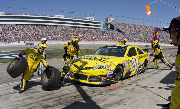 Matt Kenseth makes an early pit stop during the NASCAR Sprint Cup Series auto race, Sunday, March 10, 2013 in Las Vegas. (AP Photo/Julie Jacobson)