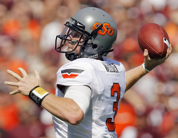 OKLAHOMA STATE UNIVERSITY: OSU's Brandon Weeden (81) passes during a college football game between the Oklahoma State Cowboys and the Texas A&M Aggies at Kyle Field in College Station, Texas, Saturday, Sept. 24, 2011. Photo by Nate Billings, The Oklahoman  ORG XMIT: KOD