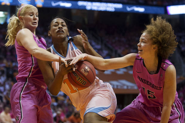 Tennessee's Bashaara Graves, center, is pressured by Vanderbilt's Heather Bowe, left, and Jasmine Jenkins during their NCAA college basketball game, Sunday, Feb. 17, 2013, in Knoxville, Tenn. (AP Photo/The Knoxville News Sentinel, Saul Young)