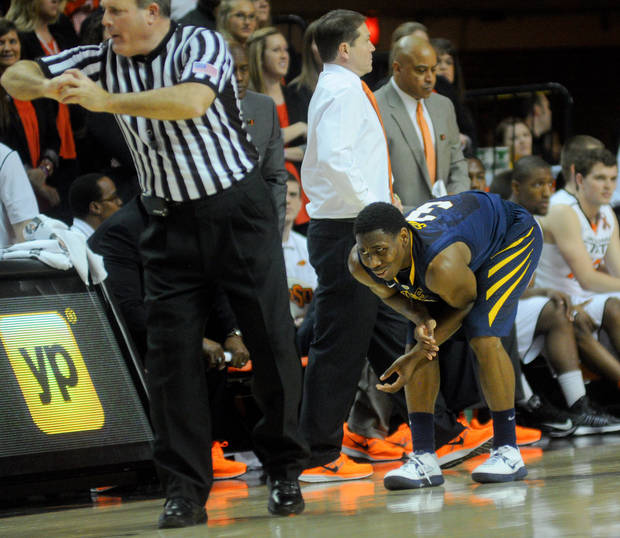 West Virginia guard Juwan Staten show his frustration to a decision by an official during an NCAA college basketball game against Oklahoma State in Stillwater, Okla., Saturday, Jan. 26, 2013. (AP Photo/Tulsa World, KT King)  ONLINE OUT; TV OUT; TULSA OUT