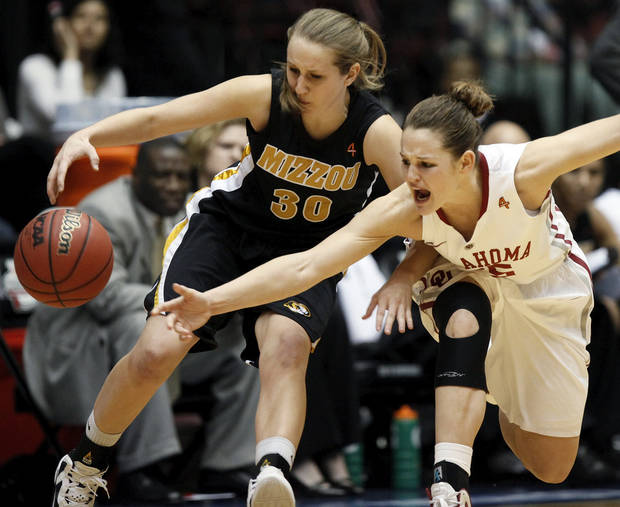 OU's Whitney Hand (25) and Missouri's Morgan Eye (30) chase the ball during the Big 12 tournament women's college basketball game between the University of Oklahoma Sooners and the University of Missouri Tigers at Municipal Auditorium in Kansas City, Mo., Thursday, March 8, 2012. OU won, 70-59. Photo by Nate Billings, The Oklahoman