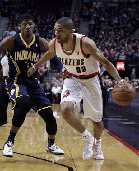Portland Trail Blazers forward Nicolas Batum, right, from France, drives past Indiana Pacers forward Paul George during the first quarter of an NBA basketball game in Portland, Ore., Wednesday, Jan. 23, 2013. (AP Photo/Don Ryan)