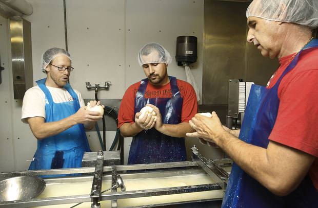 Shawn Duffy, Kyle Arpoika and Sam Lovera make fresh cheese at Lovera's  Italian Market in Krebs, Oklahoma. <strong>Jim Beckel - THE OKLAHOMAN</strong>