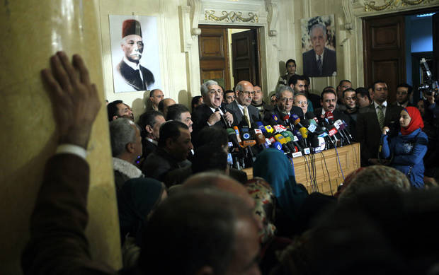 Former Egyptian presidential candidate, Hamdeen Sabahi, center left, speaks during a press conference following the meeting of the National Salvation Front as former director of the U.N.'s nuclear agency and Nobel peace laureate, Mohamed El Baradei, center, and former Egyptian Foreign Minister and presidential candidate, Amr Moussa, center right, listen in Cairo, Egypt, Monday, Jan. 28, 2013. Egypt�s main opposition coalition has rejected the Islamist president�s call for dialogue to resolve the country�s political crisis, unless their conditions are met. (AP Photo/Amr Nabil