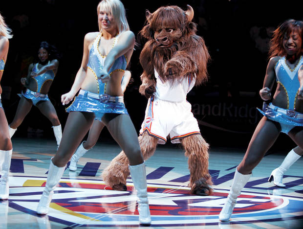 Rumble the Bison, the Oklahoma City Thunder's new mascot, dances with the Thunder girls during his halftime introduction in Tuesday's game against New Orleans at the Ford Center. Photo by bryan terry, the oklahoman