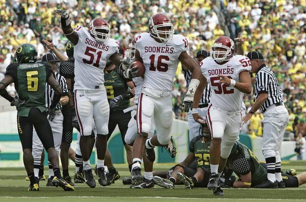 OU deep snapper Derek Shaw (52) and teammate DeMarrio Pleasant (51) celebrate after OU's Lewis Baker (16) recovered a fumble against Oregon in 2006. (Photo by Nate Billings)