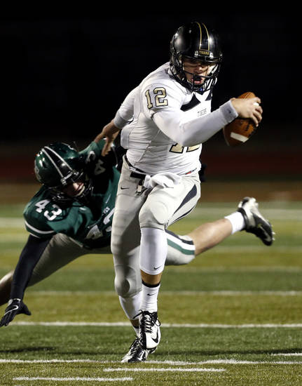 Broken Arrow quarterback Coleman Key runs past Norman North Timberwolves&#039; Kaden McClellan in class 6A football on Friday, Nov. 16, 2012 in Norman, Okla.  Photo by Steve Sisney, The Oklahoman