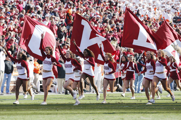 Cheer and Pom Squads lead the team onto the field for the Bedlam college football game between the University of Oklahoma Sooners (OU) and the Oklahoma State University Cowboys (OSU) at Gaylord Family-Oklahoma Memorial Stadium in Norman, Okla., Saturday, Nov. 24, 2012. Photo by Steve Sisney, The Oklahoman