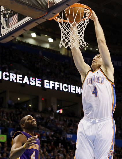 Oklahoma City&#039;s Nick Collison (4) dunks next to Los Angeles&#039; Antawn Jamison (4) during an NBA basketball game between the Oklahoma City Thunder and the Los Angeles Lakers at Chesapeake Energy Arena in Oklahoma City, Friday, Dec. 7, 2012. Photo by Nate Billings, The Oklahoman