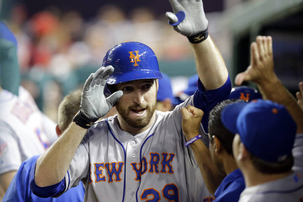 New York Mets' Ike Davis celebrates his two-run home run with his teammates during the fourth inning of a baseball game against the Washington Nationals at Nationals Park, Friday, Aug. 30, 2013, in Washington. (AP Photo/Alex Brandon)