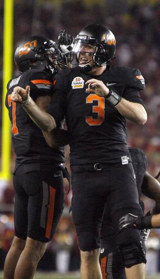 Oklahoma State's Brandon Weeden (3) and Michael Harrison (7) celebrate a Weeden touchdown during the Fiesta Bowl between the Oklahoma State University Cowboys (OSU) and the Stanford Cardinal at the University of Phoenix Stadium in Glendale, Ariz., Monday, Jan. 2, 2012. Photo by Sarah Phipps, The Oklahoman