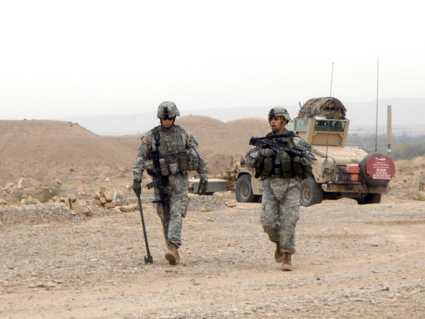 1st Lt. Michael Behenna, left, walks with a soldier while on mission in Iraq. Photo provided by the Behenna Family