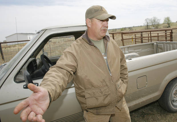 Calvin England describes waking a woman and getting her out of her house just minutes before it was destroyed in Thursdays fires north of Lindsay, Friday, April 10, 2009. England did not know the woman and doesn�t know how he new to saver her.  Photo By David McDaniel, The Oklahoman.