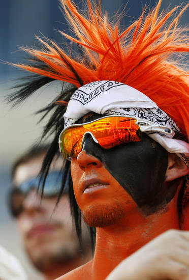 OSU student Conner Bayliff of Gardner, Kansas, watches OSU warm up before a college football game between Oklahoma State University (OSU) and Savannah State University at Boone Pickens Stadium in Stillwater, Okla., Saturday, Sept. 1, 2012. Photo by Nate Billings, The Oklahoman