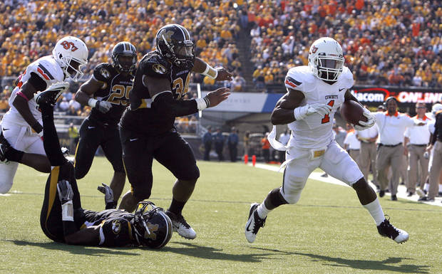 Oklahoma State's Joseph Randle (1) gets by the Missouri defense for a touchdown during a college football game between the Oklahoma State University Cowboys (OSU) and the University of Missouri Tigers (Mizzou) at Faurot Field in Columbia, Mo., Saturday, Oct. 22, 2011. Photo by Sarah Phipps, The Oklahoman