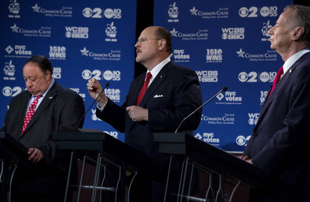 Mayoral candidate Joe Lhota, center, squares off with other New York Republican mayoral candidates during a television debate in New York Wednesday, Aug. 28, 2013. Left is candidate John Catsimatidis, and right is George McDonald. (AP Photo/Craig Ruttle)