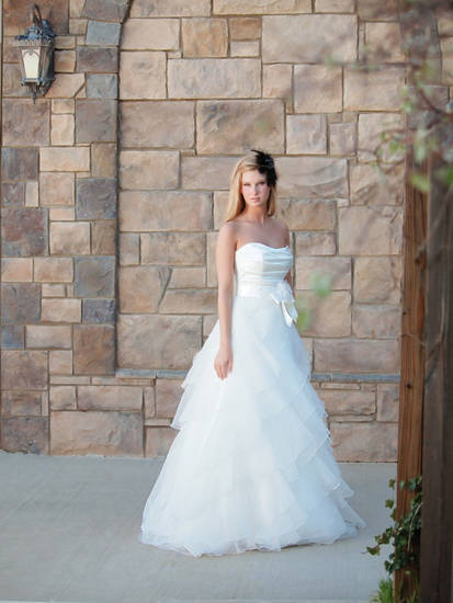Mikaella diamond color A-line gown with organza skirt and satin bodice. Sold at Moliere Bridal. Photo provided.  <strong>REVELphoto by Misty Bradley</strong>