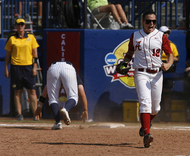 Alabama's Cassie Reilly-Boccia (18) celebrates after tagging California's Danielle Henderson (8) during a Women's College World Series game between Alabama and California at ASA Hall of Fame Stadium in Oklahoma City, Sunday, June 3, 2012.  Photo by Garett Fisbeck, The Oklahoman