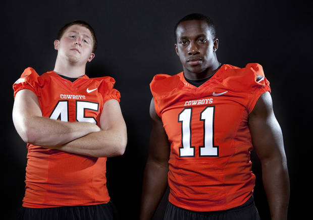 Oklahoma State's Caleb Lavey (45) and Shaun Lewis (11) pose for a photo during Oklahoma State's Football media day at  in Stillwater, Okla., Saturday, Aug. 6, 2011. Photo by Sarah Phipps, The Oklahoman