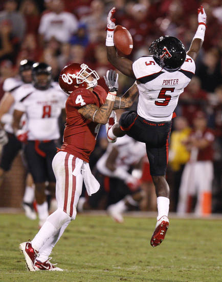 Texas Tech's Tre' Porter (5) intercepts a pass beside Oklahoma's Kenny Stills (4) during the college football game between the University of Oklahoma Sooners (OU) and the Texas Tech University Red Raiders (TTU) at Gaylord Family-Oklahoma Memorial Stadium in Norman, Okla., Saturday, Oct. 22, 2011. Photo by Bryan Terry, The Oklahoman