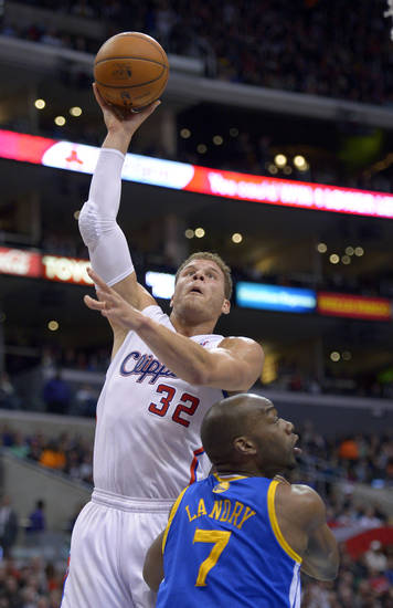 Los Angeles Clippers forward Blake Griffin, left, shoots over Golden State Warriors forward Carl Landry during the first half of their NBA basketball game, Saturday, Jan. 5, 2013, in Los Angeles.  (AP Photo/Mark J. Terrill)