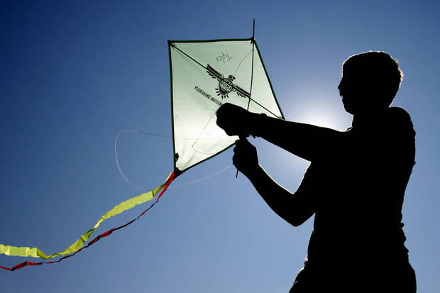 Oklahoma Christian University freshman Ben Marshall prepares to fly a kite in Oklahoma City , Wednesday August 22, 2012. Photo By Steve Gooch, The Oklahoman