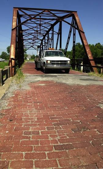 Old, Old, Route 66 bridge  west of Sapulpa  wild art for upcoming RT 66 festival  Staff photo by Paul B. Southerland
