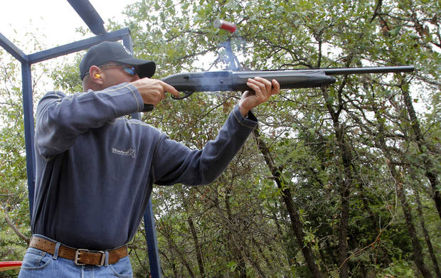 John Mullins shoots at a clay target at the Edmond Area Chamber of Commerce's annual sporting clays tournament at Silverlead Shotgun Sports in Guthrie. PHOTO BY PAUL HELLSTERN, THE OKLAHOMAN. <strong>PAUL HELLSTERN - OKLAHOMAN</strong>