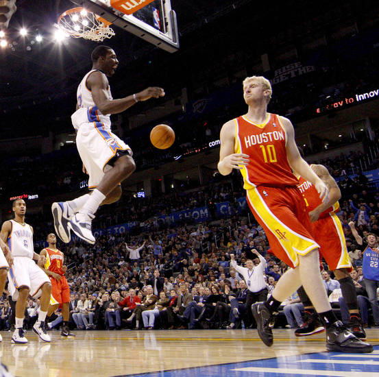 Oklahoma City's Jeff Green reacts after a dunk beside Houston's Chase Budinger during the NBA basketball game between the Oklahoma City Thunder and the Houston Rockets at the Oklahoma City Arena on Wednesday, December 15,  2010.   Photo by Bryan Terry, The Oklahoman