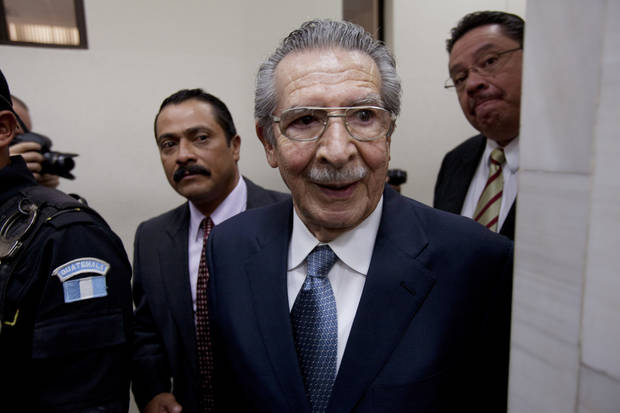 Guatemala's former dictator Efrain Rios Montt (1982-1983) leaves the courtroom after his pre-trial hearing in Guatemala City, Thursday, Jan. 24, 2013. A judge in Guatemala has begun pre-trial hearings in a genocide case against former dictator Efrain Rios Montt, who is accused of overseeing hundreds of killings when he ruled Guatemala from 1982 to 1983, at the height of the country's 36-year civil war. The war ended in peace accords in 1996, after 200,000 deaths. (AP Photo/Moises Castillo)