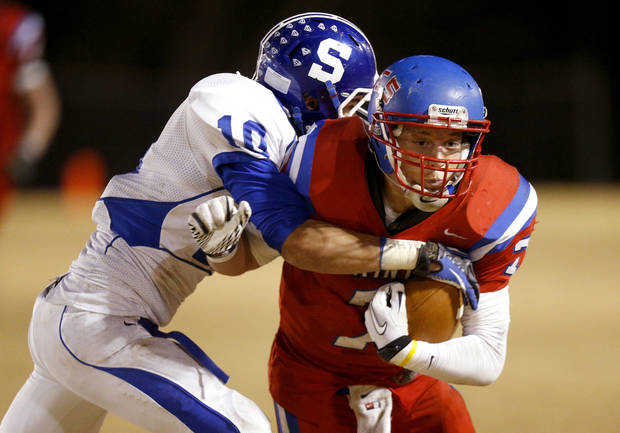 Oklahoma Christian School's Blake Barnes fights off Stroud's Dalton Baade during a high school football playoff game in Edmond, Friday, Nov. 23, 2012. Photo by Bryan Terry, The Oklahoman
