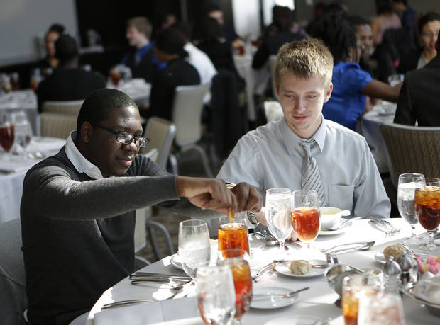 Left: Kevin Dockens and James Kyle Vanek dine during the students� lunch at Vast. Photos by Garett Fisbeck,  The Oklahoman