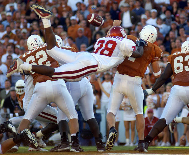OU COLLEGE FOOTBALL: OU's Roy Williams knocks the ball loose from Texas QB Chris Simms and sets up an OU interception and TD in the 4th qtr.  University of Oklahoma vs. University of Texas, October 6, 2001, in the Cotton Bowl in Dallas. Photo by Paul Hellstern