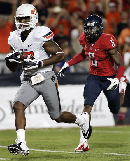 Oklahoma States' Tracy Moore (87) outruns Arizona's Shaguille Richardson (5) for a touchdown during the first half of an NCAA college football game at Arizona Stadium in Tucson, Ariz., Saturday, Sept. 8, 2012. (AP Photo/John Miller)