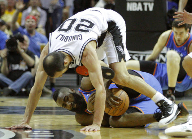 Oklahoma City's James Harden (13) fights for the ball under San Antonio's Manu Ginobili (20) during Game 1 of the Western Conference Finals between the Oklahoma City Thunder and the San Antonio Spurs in the NBA playoffs at the AT&T Center in San Antonio, Texas, Sunday, May 27, 2012. Photo by Bryan Terry, The Oklahoman