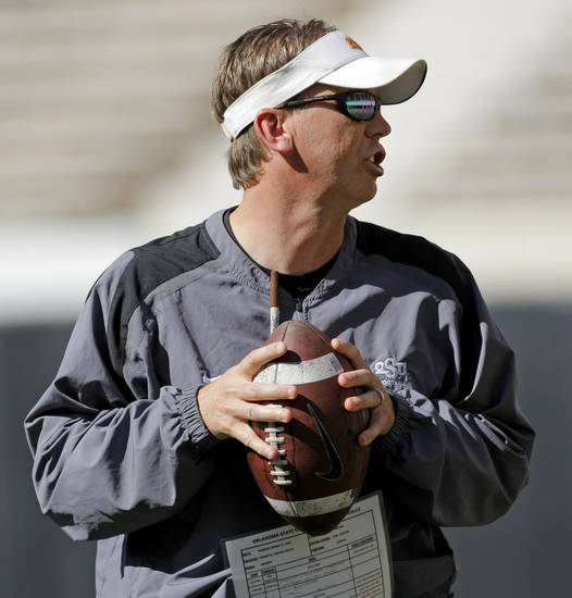 Todd Monken works with the quarterbacks during OSU spring football practice at Boone Pickens Stadium on the campus of Oklahoma State University in Stillwater, Okla., Monday, March 12, 2012. Photo by Nate Billings, The Oklahoman