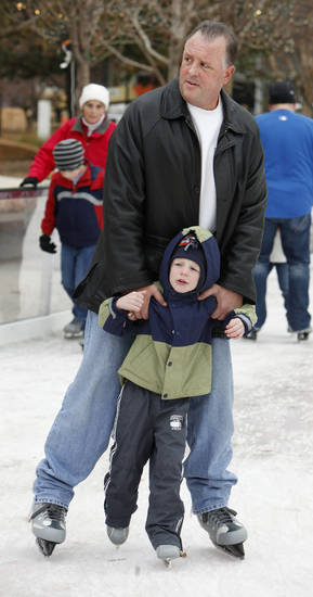 CHILD / CHILDREN / KIDS / ICE SKATING RINK: Jeff Draper and son Jack Draper, 3, from Tulsa, skating at the Devon ice rink at the Myriad Gardens in downtown Oklahoma City Thursday, Dec. 22, 2011. Photo by Paul B. Southerland, The Oklahoman ORG XMIT: KOD
