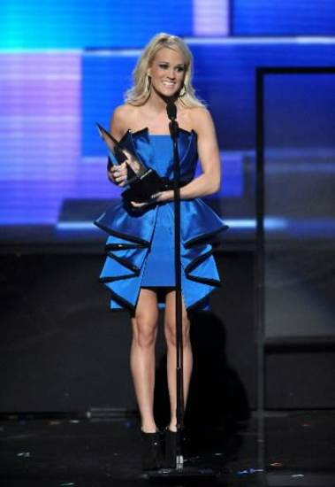 "Carrie Underwood accepts the Favorite Country Album award for ""Blown Away."""