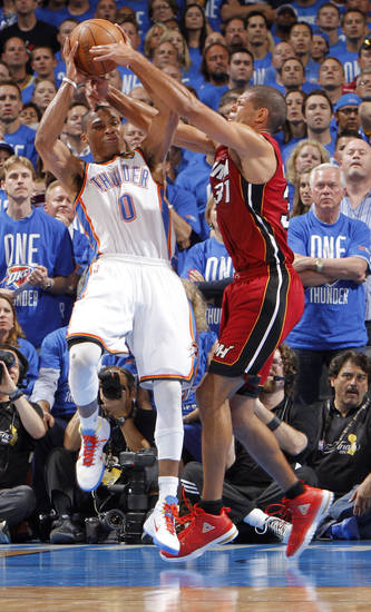 Miami's Shane Battier (31) defends Oklahoma City's Russell Westbrook (0) during Game 1 of the NBA Finals between the Oklahoma City Thunder and the Miami Heat at Chesapeake Energy Arena in Oklahoma City, Tuesday, June 12, 2012. Photo by Chris Landsberger, The Oklahoman