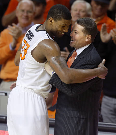 Oklahoma State's Marcus Smart (33) is greeted by coach Travis Ford as he exits the game during an NCAA college basketball game between Oklahoma State and Memphis at Gallagher-Iba Arena in Stillwater, Okla., Tuesday, Nov. 19, 2013. Photo by Bryan Terry, The Oklahoman