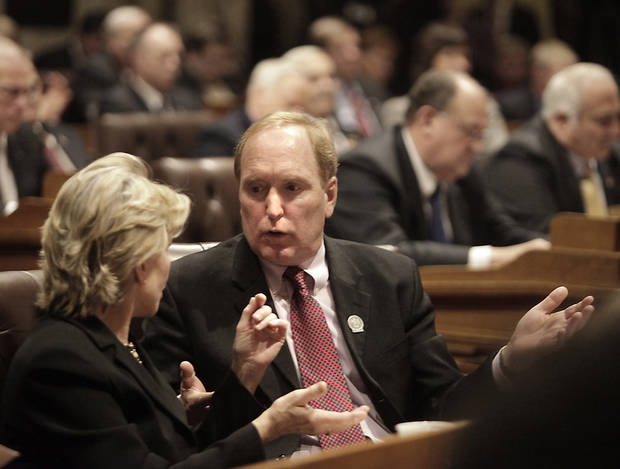 Wisconsin Democratic Assembly members Gary Hebl, D-Sun Prairie, and Janet Brewley, D-Ashland, discuss a proposal made by Governor Scott Walker during his state budget address at the Wisconsin State Capitol in Madison, Wis. Wednesday, February 20, 2013.  (AP Photo/Wisconsin State Journal, John Hart)